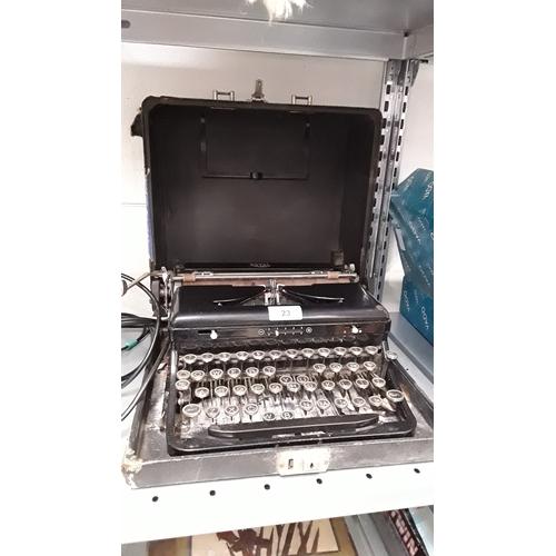 23 - A vintage Royal typewriter in case....