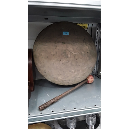 26 - A gong with hammer....