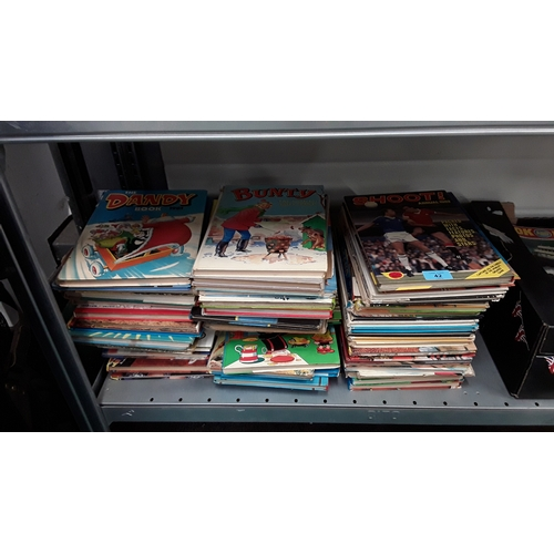 42 - A large collection of vintage comic and other annuals dating from the 1960's through to the 1990's....