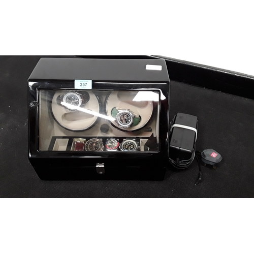 257 - A large watch winder containing a collection of gents watches....