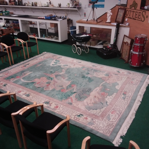 316 - A Chinese wool and cotton rug of the Temple Green design. Measures 365 x 270cms, hand knotted....