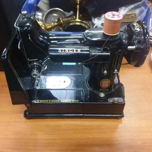 411 - A vintage Singer 222K electric sewing machine with instructions, accessories, foot pedal and case....