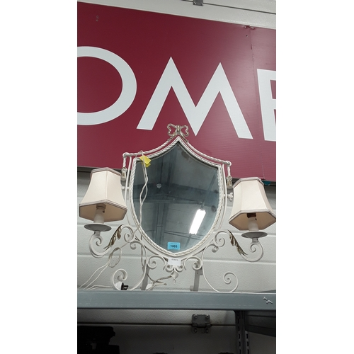 1005 - An ornate metal framed mirror with attached light fitments....