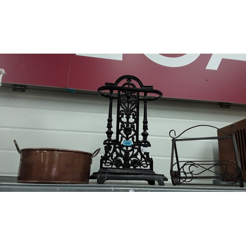 1006 - A Victorian style umbrella/stick stand together with a copper pot and metal shoe rack....