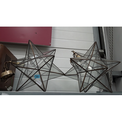 1008 - Two decorative brass and glass star shaped light fitments....