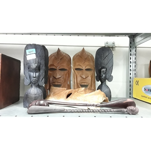 1017 - A collection of African tribal masks and carvings....
