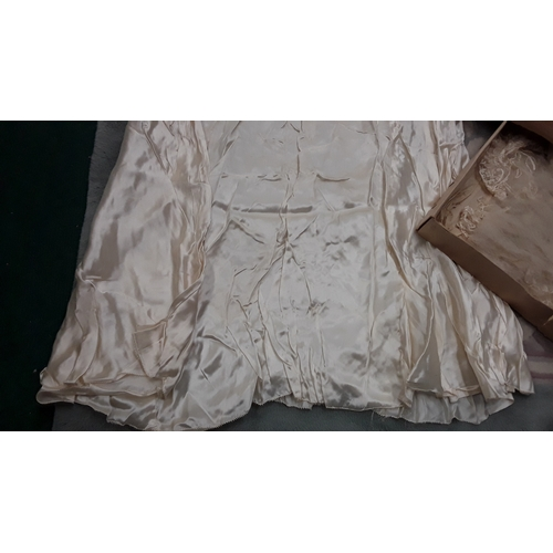 1026 - An antique late 19th/early 20th Century silk wedding dress and Veil....