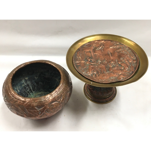 1029 - A brass and copper centre table stand together with a decorative copper bowl....
