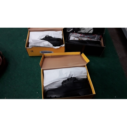1045 - Three boxed pairs of mens work boots. All size 12....