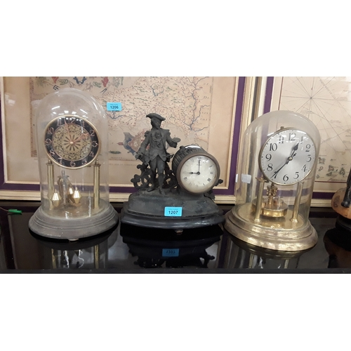 1207 - Two vintage anniversary clocks in glass domes together with an 8 day French style mantle clock....