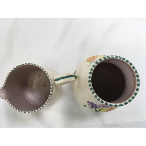 22 - Poole Pottery shape 433 JX pattern jug by Eileen Prangnell together with a shape 319 JX pattern jug ...
