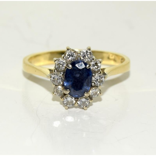 2217 - A Diamond and Sapphire 18ct gold ring....