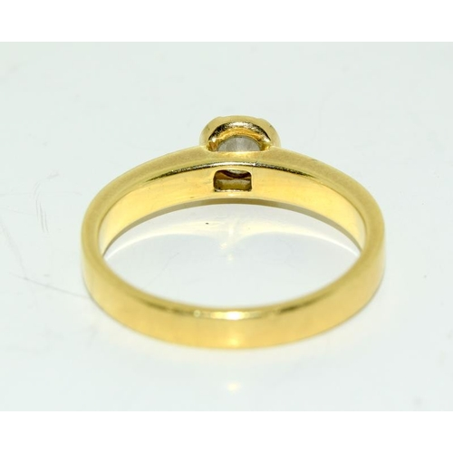 2218 - An 18ct gold Diamond ring (approx. 0.33 points) with diamond shoulders....