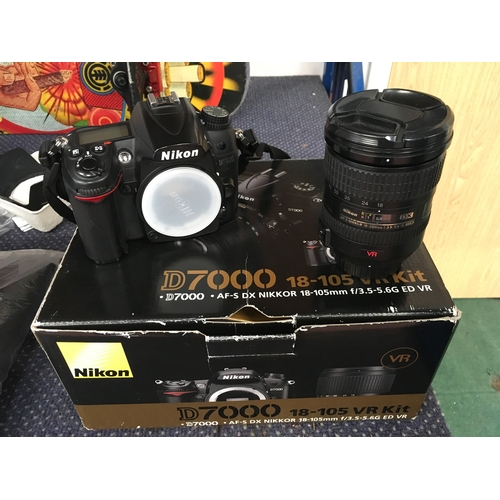 2302 - A Nikon D7000 SLR camera with a Nikkor 18-105mm VR lens (Ref:5)....