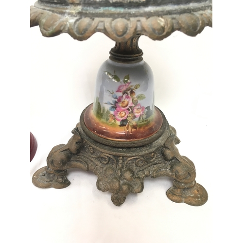 1009 - A metal and porcelain pot stand together with a vintage school bell....