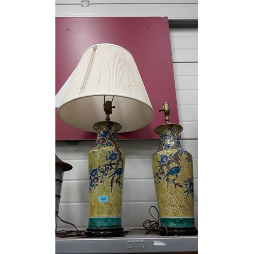1007 - A pair of oriental style table lamps decorated with birds and flowers....