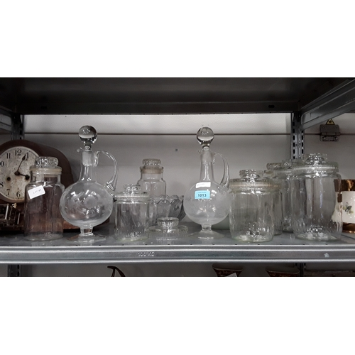 1013 - A large collection of assorted glassware to include storage jars....