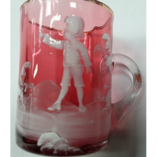 1034 - Three Cranberry glass items and a small Cranberry glass Mary Gregory mug with white figure decoratio...