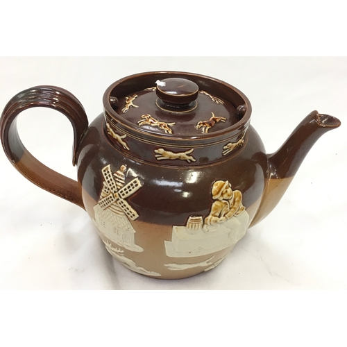1035 - A Royal Doulton Sea Shanty Jug, Harvest ware teapot and an ornate pot....
