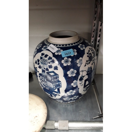 1037 - A large oriental style blue and white ceramic ginger jar....