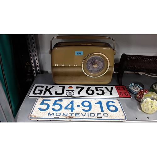 1045 - A retro Bush radio together with two number plates....