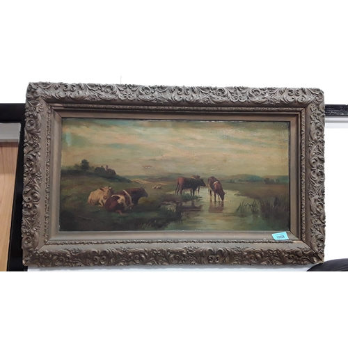 1058 - A framed oil on canvas of cows on a river. Signed to bottom right hand corner....