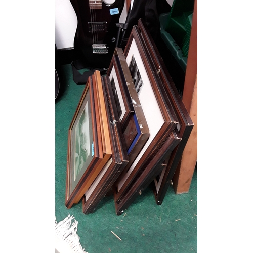 1061 - A collection of framed photographs....