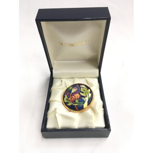 41 - Moorcroft boxed brooch....