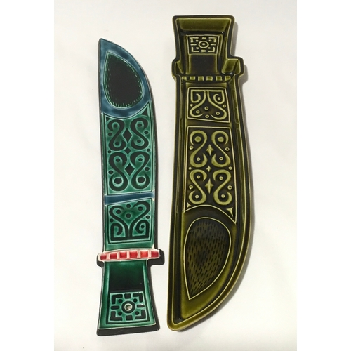 115 - Poole Pottery dagger plaque and dagger tray designed by Robert Jefferson....