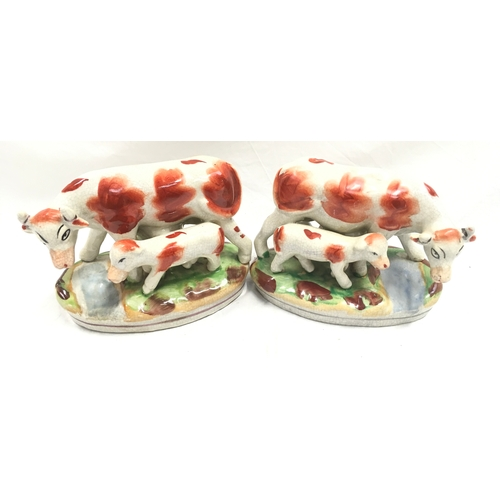12 - A pair of Staffordshire cow and calf figures....