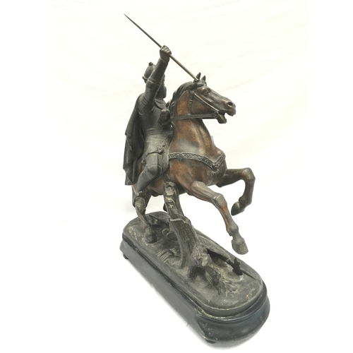 13 - Spelter statue of a knight on horse....