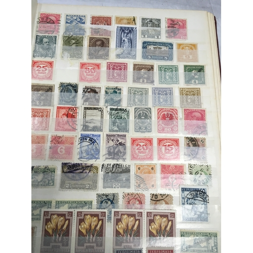 254 - A red album of World stamps....