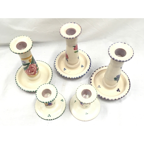 17 - Poole Pottery shape 262 FQ pattern candlestick together with another WV pattern, FJ pattern and a pa...