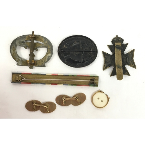 216 - WWII Nazi insignial badges etc....