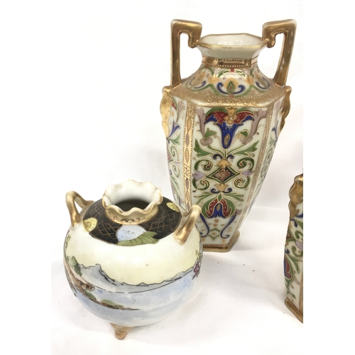 7 - Noritake: pair of vases and one other pair and a single vase....