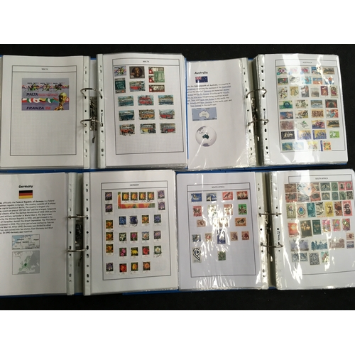 202 - Four albums of world stamps....
