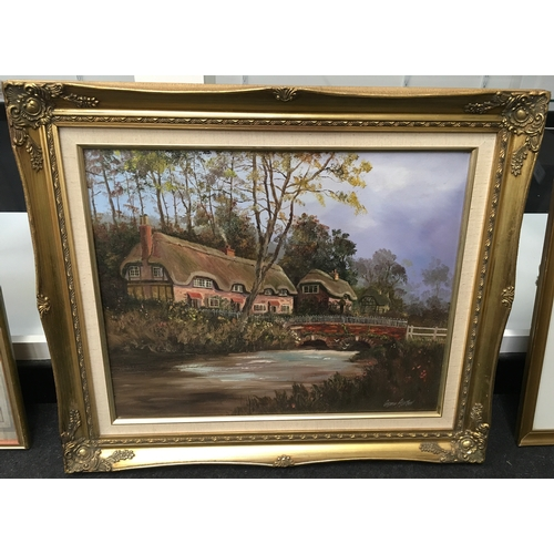 531 - A gilt framed country scene of a thatched cottage, signed Glynn Ashton. 55 x 70 cms....