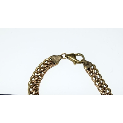 2080 - A 9ct gold ladies double Figaro bracelet....