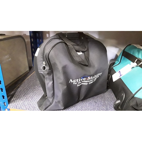 2059 - Four Active Mobility scooter batteries in carry bag (REF 7)....