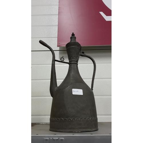 1002 - A decorative cast metal jug....
