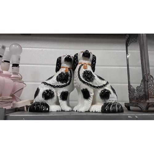 1004 - A pair of Staffordshire flatback spaniels....