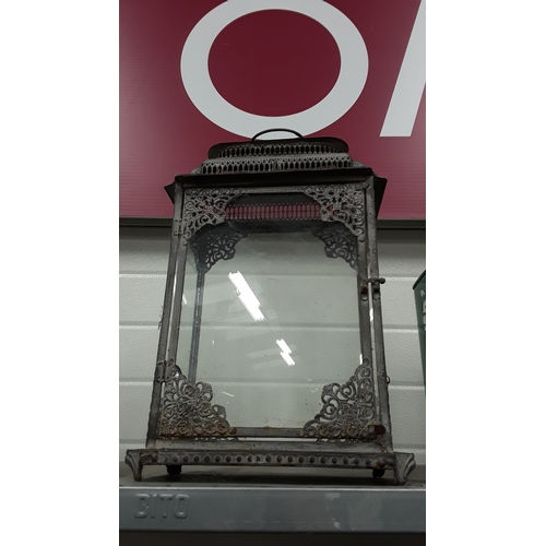 1005 - A decorative outdoor metal glazed candle holder....