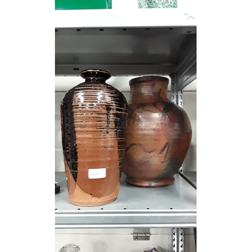 1019 - Two large pottery vases....