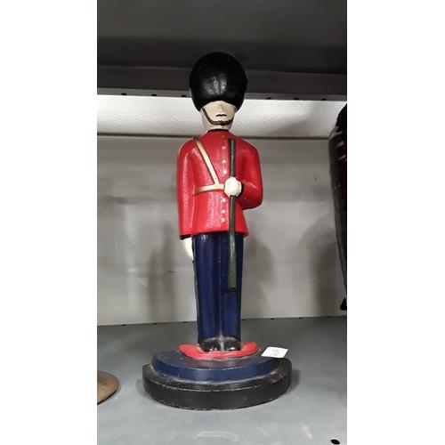 1020 - A cast iron Guardsman figure....