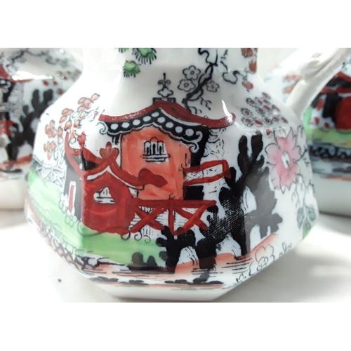 1034 - Three graduated Mason's jug in the Pagoda pattern....