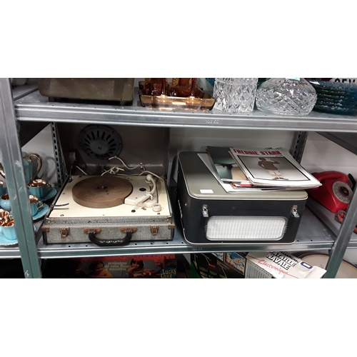 1043 - A vintage Bush record player together with a vintage Stella record player and a collection of music ...