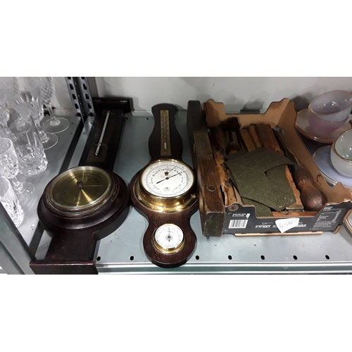1045 - Two barometers with a box containing a small amount of vintage tools....