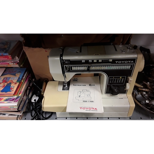 1049 - A Toyota 7001 sewing machine with instructions and original box....