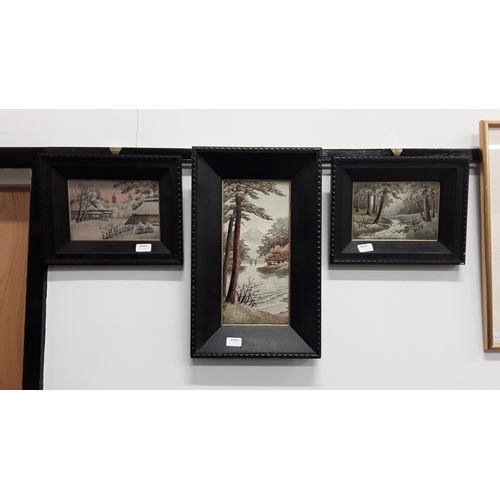 1058 - A set of three framed and glazed oriental silk pictures....