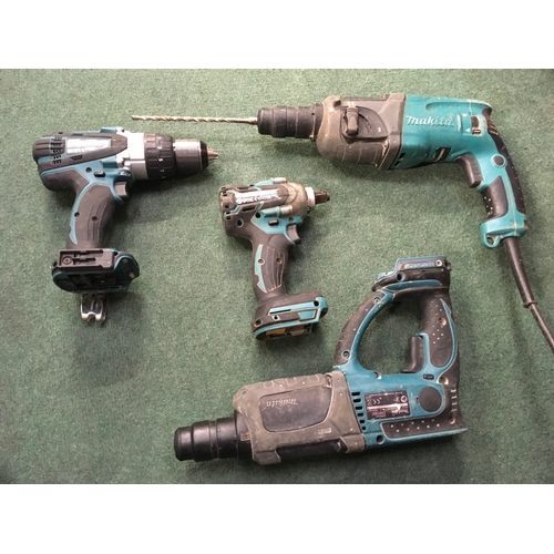 2058 - A Makita bag containing a collection of Makita power tools (REF 1)....